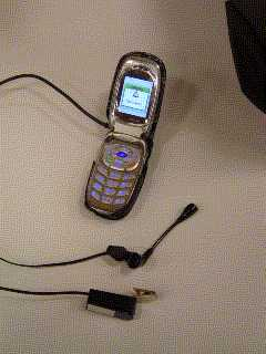 A670 clamshell cell phone with Y-cable connected to microlite switch and handsfree headset