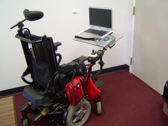 Image of Power wheelchair with laptop and trackball mounted on tubing